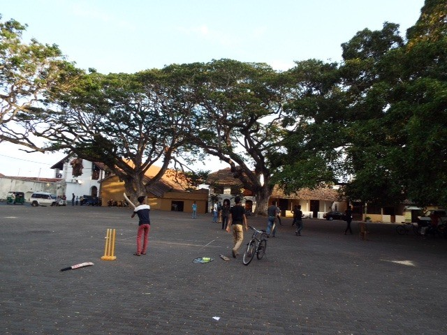 Local boys playing cricket.