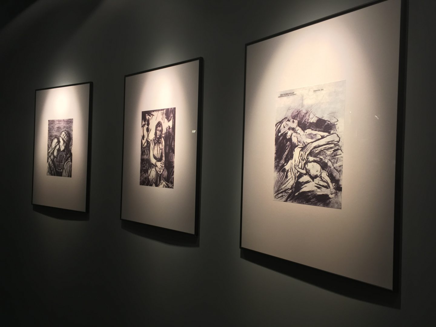 Artist drawings of Auschwitz victims on the walls of Auschwitz exhibition