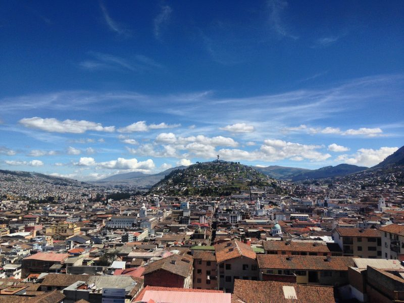 The view of Quito, featuring a lot of roofs and structures