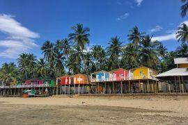 colourful beach huts on the beach in Goa India