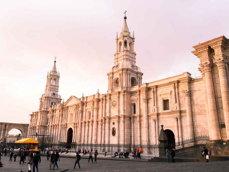 the front of the basilica cathedral of Arequipa, or la catedral, in Peru at sunset
