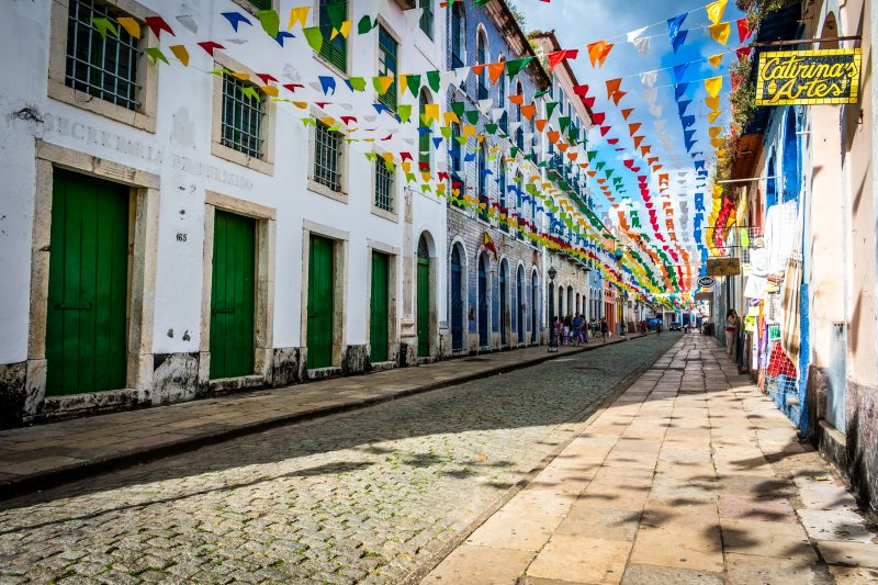 Colourful flags above a cobbled street in the Historic Centre of São Luís in Brazil