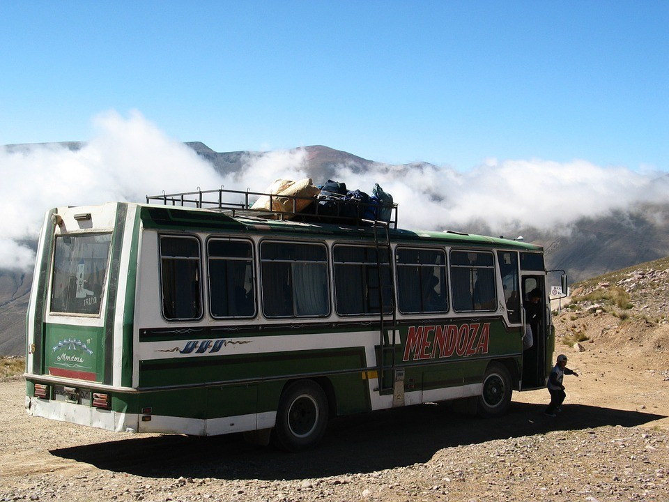 Bus travel in Peru - a South American minibus navigating the Andes