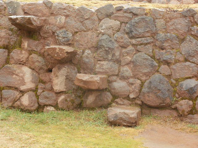 Stone slabs embedded into the walls at Moray ruins to create crude staircases