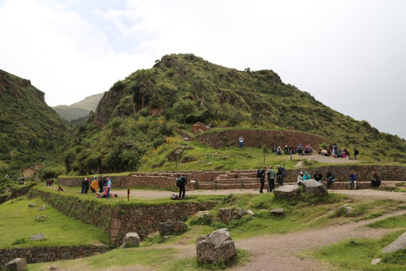 A crowd of people exploring Pisac Ruins in Pisac, Peru's Sacred Valley
