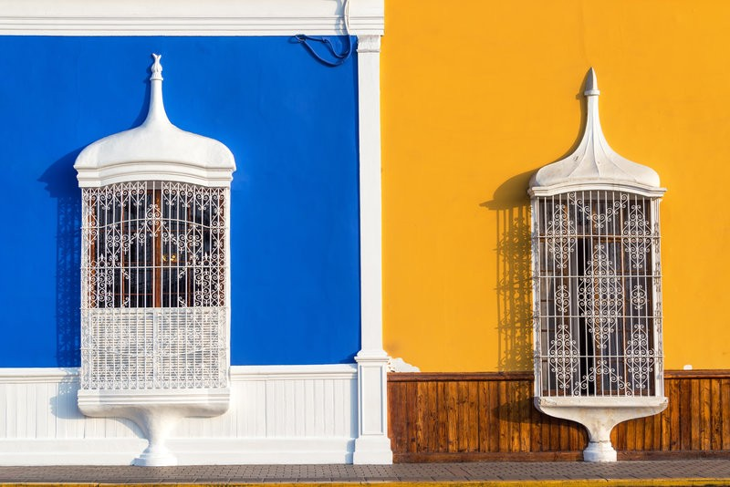 colourful blue and yellow colonial buildings in Trujillo, Peru