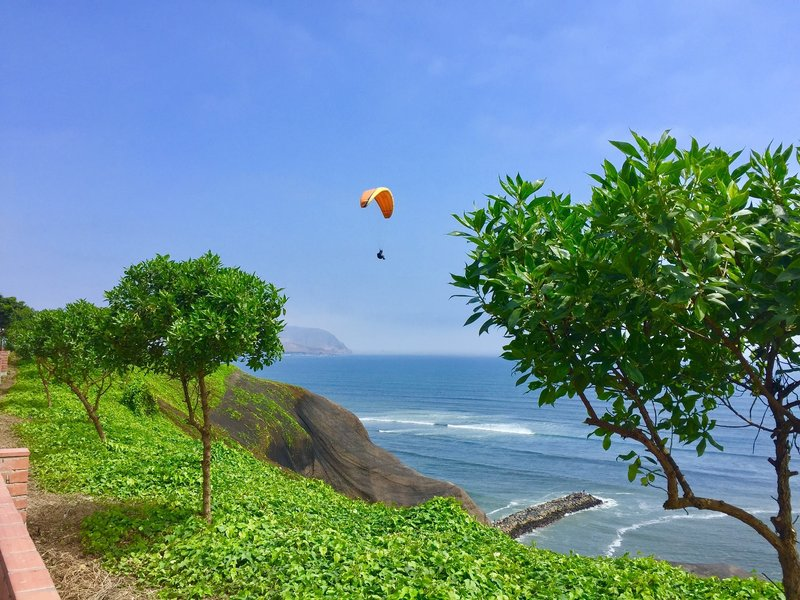 Paragliding along El Malecon in Miraflores, the best place to stay in Lima
